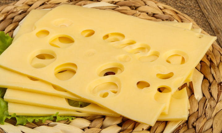 basket of emmental cheese slices